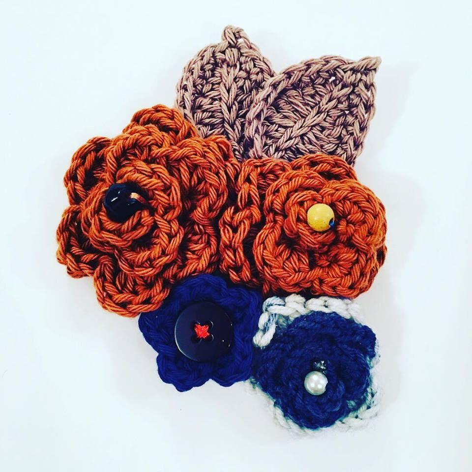 Beaded flowers usedto create a vintage crochet brooch